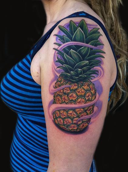 Cool pineapple tattoo on  arm