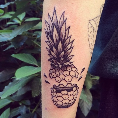 Exploded pineapple tattoo on arm