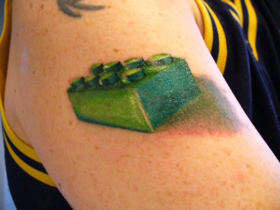 Green lego brick tattoo
