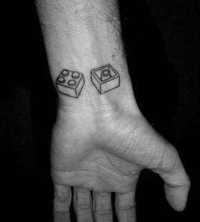 Lego blocks on wrist tattoo