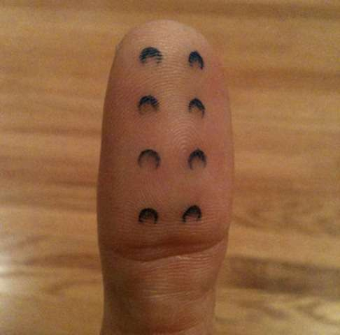 Lego brick finger tattoo
