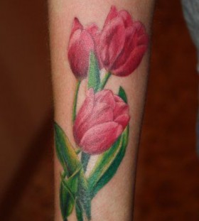 Pink and green tulip tattoo