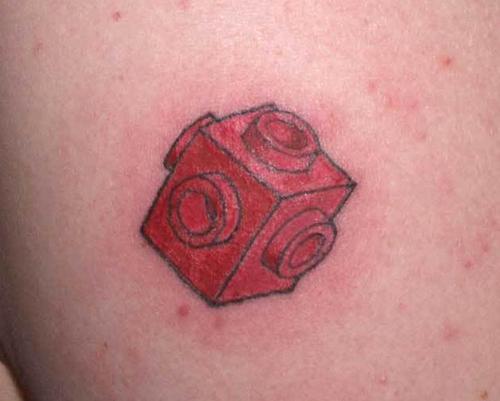 Red lego brick tattoo