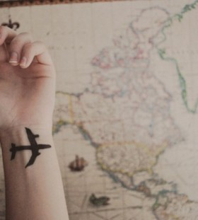 Simple airplane tattoo on wrist