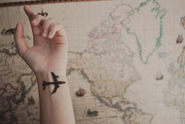 Simple airplane tattoo on wrist