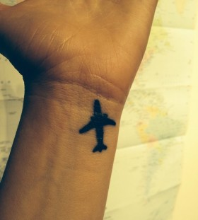 Simple and beautiful airplane tattoo on wrist