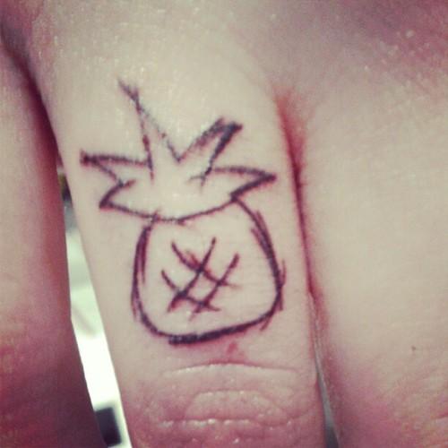 Simple pineapple tattoo on finger