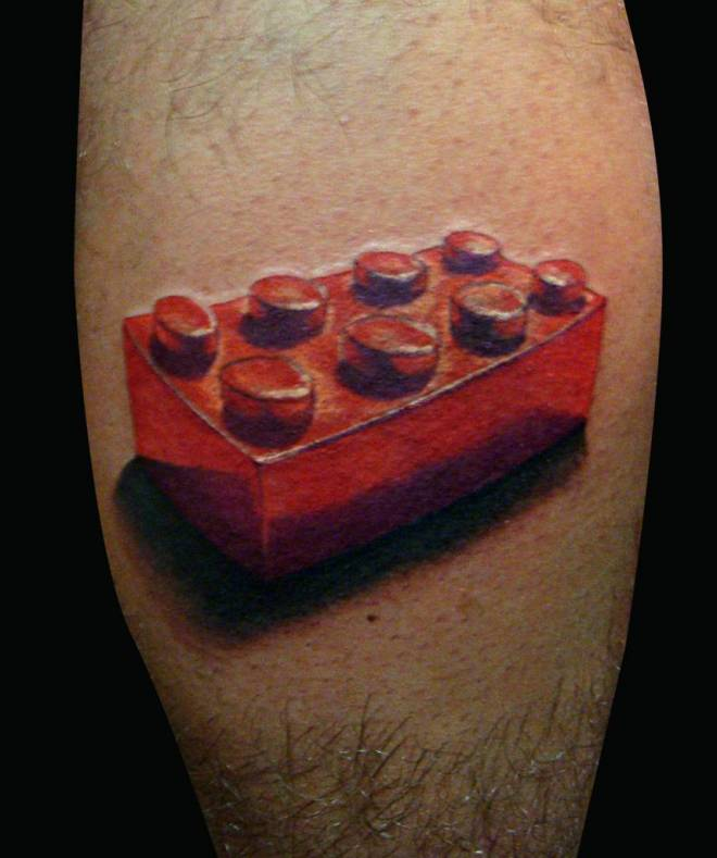 Simple red lego brick tattoo