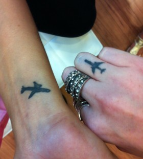 Small airplanes tattoos