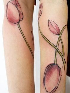 Wonderful looking tulip tattoo