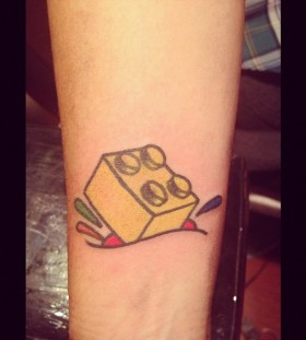 Yeallow lego brick tattoo