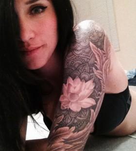 Black hair girl's lotus flower tattoo