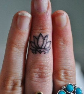 Cruel nails and lotus flower tattoo
