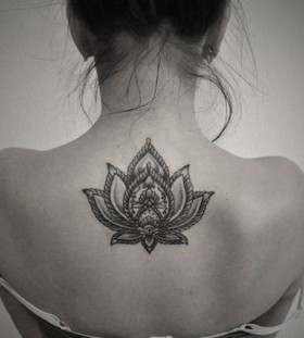 Realistic woman's back lotus flower tattoo