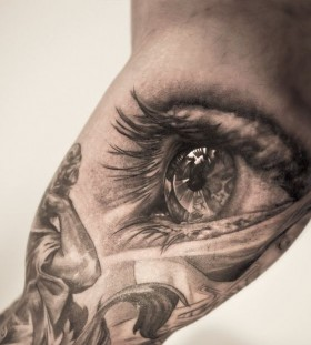 Adorable black eye tattoo