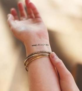 Adorable simple wrist tattoo