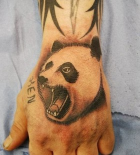 Aggressive  panda bear arm tattoo