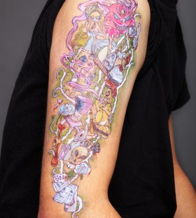 Alice In Wonderland arm tattoo