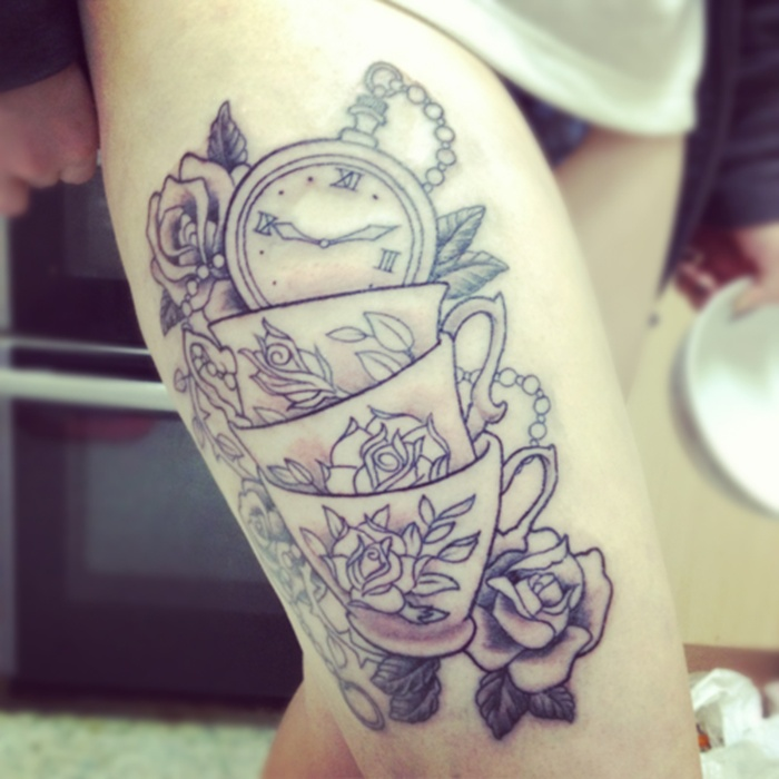 Alice Wonderland cups with roses leg tattoo