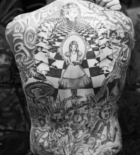 Alice in Wonderland back tattoo