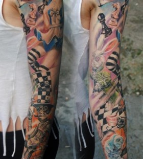 Alice in Wonderland theme arm tattoo