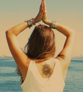 Amazing bohemian style back tattoo