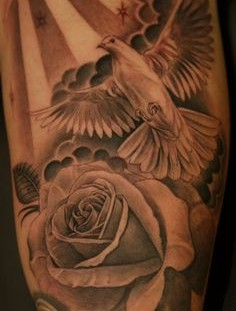 Amazing dove and rose tattoo