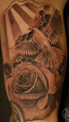Amazing dove and rose tattoo