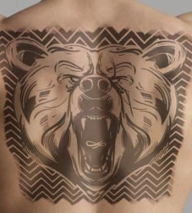 Angry bear tattoo on back
