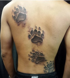 Awesome bear foot tattoo on back