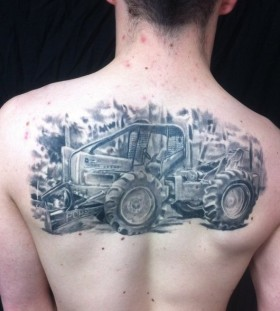Awesome black tractor tattoo
