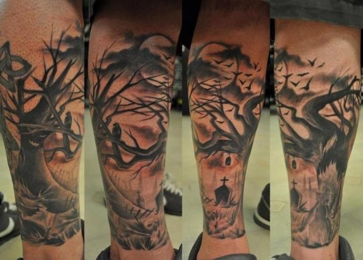 Awesome graveyard theme leg tattoo