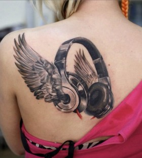 Awesome headphones with wings tattoo