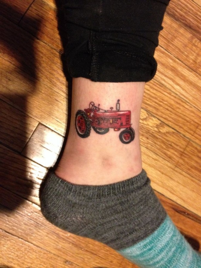 Awesome red tractor tattoo