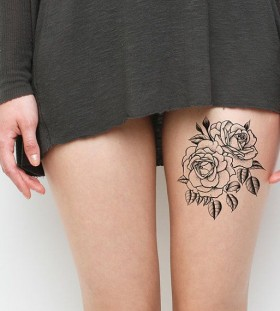 Awesome women's leg rose tattoo