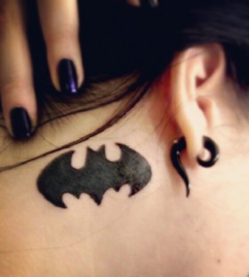 Batman logo tattoo behind the ear