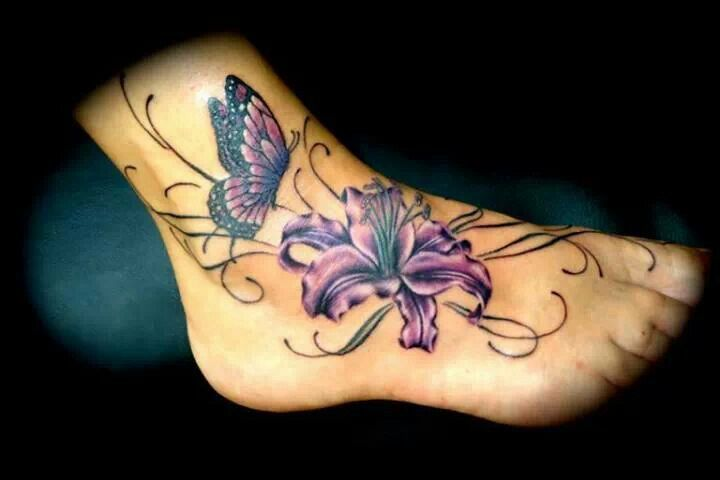 Beautiful orchid and butterfly foot tattoo