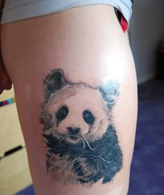 Beautiful panda beat tattoo