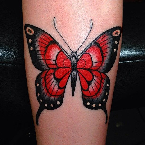 Black and awesome red butterfly tattoo