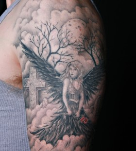 Black angel arm tattoo