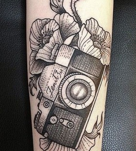 Black camera and poppies tattoo