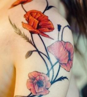Black great poppies tattoo