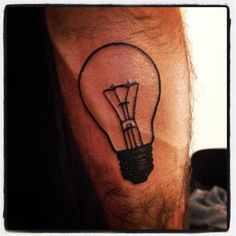 Black lightbulb tattoo