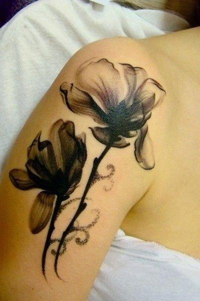 Black mindblowing watercolor tattoo