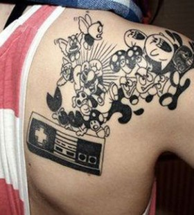 Black shoulder mario style tattoo