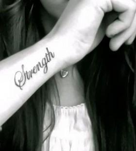 Black strength wrist tattoo
