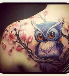 Blue adorable owl tattoo on shoulder