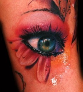 Blue and crying eye tattoo