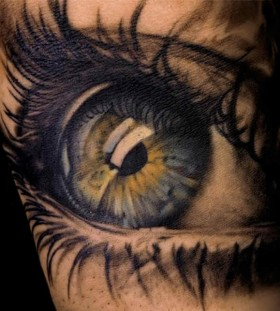 Blue and green eye tattoo
