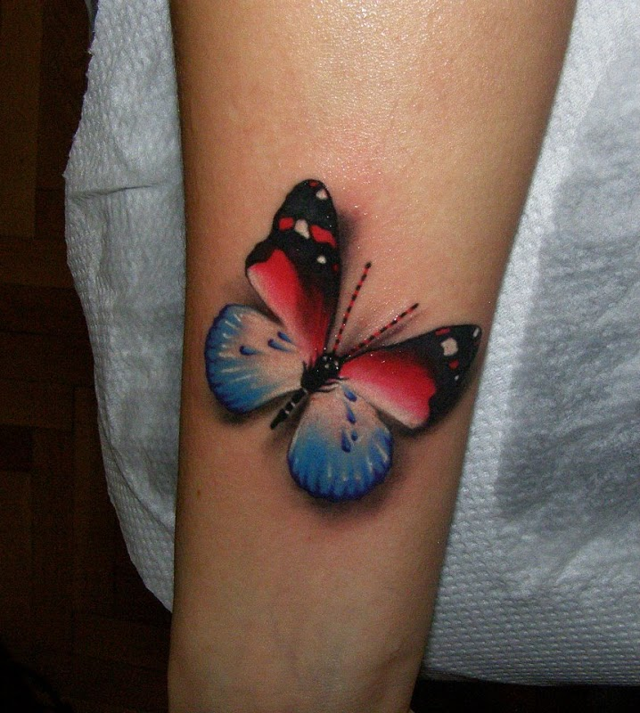 Blue, black and red butterfly tattoo